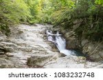 Stock photo waterfall at autumn forest selva de irati fall beech jungle in navarra pyrenees of spain cascade 1083232748