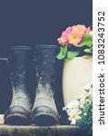 mud covered wellie boots in a... | Shutterstock . vector #1083243752