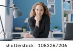 young smiling woman sitting at...   Shutterstock . vector #1083267206