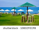 public beach with sunbeds in... | Shutterstock . vector #1083293198