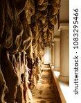 iberian cured hams stored in a... | Shutterstock . vector #1083295466