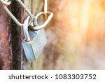 lock on a chain hangs on a gate | Shutterstock . vector #1083303752