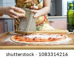 the chef in black apron makes... | Shutterstock . vector #1083314216