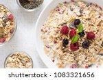 muesli with milk  chia seeds ... | Shutterstock . vector #1083321656