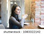young fashion woman drinks tea...   Shutterstock . vector #1083322142