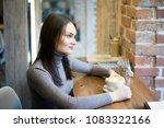 a beautiful smiling young woman ...   Shutterstock . vector #1083322166