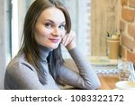 beautiful young woman smiling...   Shutterstock . vector #1083322172