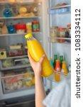 teenage girl takes the orange... | Shutterstock . vector #1083334112