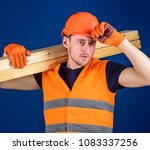 man in protective gloves holds... | Shutterstock . vector #1083337256