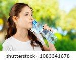 beautiful smiling young woman... | Shutterstock . vector #1083341678