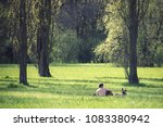 free time at the park with dog  ... | Shutterstock . vector #1083380942