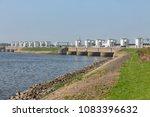 Small photo of Sluices in Dutch Afsluitdijk near Kornwerderzand for draining fresh water of the lake IJsselmeer to the salt Wadden Sea