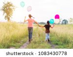blurred of two sisters running... | Shutterstock . vector #1083430778
