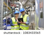 industrial engineers working in ... | Shutterstock . vector #1083433565