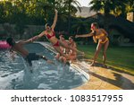 young people jumping into the...   Shutterstock . vector #1083517955