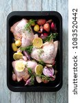 raw redy to bake chicken legs... | Shutterstock . vector #1083520442