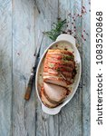 oven roasted pork loin wrapped... | Shutterstock . vector #1083520868