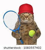 Stock photo the cat in a red cap is holding a tennis racket and a ball white background 1083557402