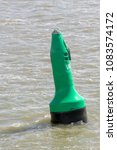 green buoy as a marker for... | Shutterstock . vector #1083574172