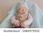newborn tiny gentleman wearing... | Shutterstock . vector #1083575522