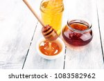 pouring aromatic honey into jar ... | Shutterstock . vector #1083582962