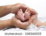 newborn baby feet in father 's...   Shutterstock . vector #108360035