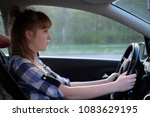 portrait of a girl driver | Shutterstock . vector #1083629195