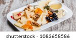 cheese platter garnished with... | Shutterstock . vector #1083658586