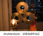 decorative golden candle holder | Shutterstock . vector #1083689162