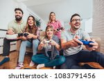 group of friends play video... | Shutterstock . vector #1083791456
