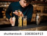 young barman in a blue shirt... | Shutterstock . vector #1083836915