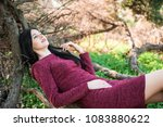 beautiful young brunette with... | Shutterstock . vector #1083880622