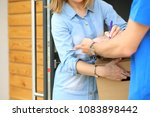 smiling delivery man in blue... | Shutterstock . vector #1083898442