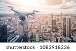 multicopter drone flying over... | Shutterstock . vector #1083918236