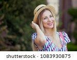 portrait of young beautiful... | Shutterstock . vector #1083930875