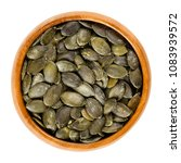 roasted and salted pepita... | Shutterstock . vector #1083939572