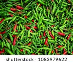 red and green ripe chillies... | Shutterstock . vector #1083979622
