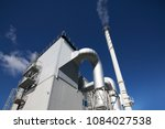 biofuel boiler house on a blue... | Shutterstock . vector #1084027538