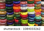 colcoful glass bangles in an... | Shutterstock . vector #1084033262