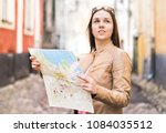 female traveler with map. woman ... | Shutterstock . vector #1084035512