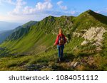 the view with the high rocky... | Shutterstock . vector #1084051112