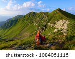 the view with the high rocky... | Shutterstock . vector #1084051115