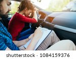 driving school. stressed and... | Shutterstock . vector #1084159376