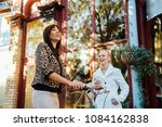 two woman in small town... | Shutterstock . vector #1084162838