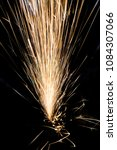 sparks on a black background... | Shutterstock . vector #1084307066