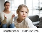 sulky angry offended kid girl... | Shutterstock . vector #1084354898