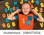 happy charming caucasian kid in ... | Shutterstock . vector #1084371026