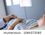doctor and patient discussing... | Shutterstock . vector #1084373585