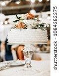 wedding cake with white cream   Shutterstock . vector #1084382375
