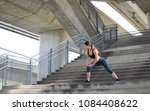 girl stretching during her... | Shutterstock . vector #1084408622